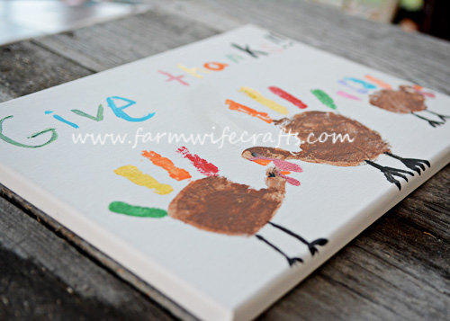 This Hand Print Turkey Canvas will look great on your wall this Thanksgiving.