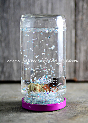These Mason Jar Snow Globes with farm animals are fun for kids to make while learning about winter on a farm.