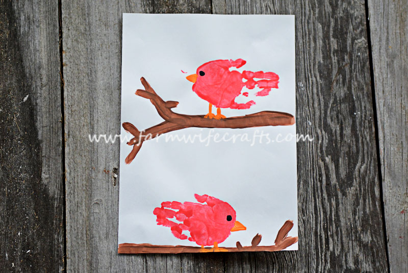An easy and fun cardinal craft using child's handprints. Perfect for any bird lover.