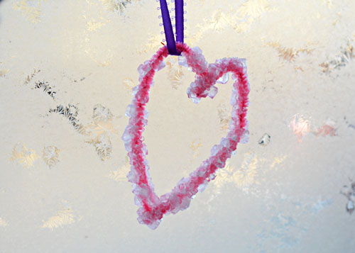 These crystal hearts with borax are a fun science experiment to celebrate Valentine's Day.