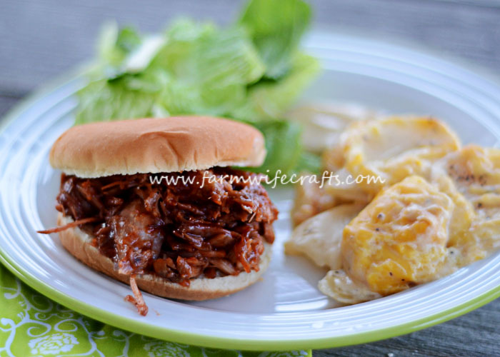 This crockpot cola BBQ pulled pork recipe is so juicy and tender. Just toss it in the crockpot and it's sure to be a crowd pleaser!