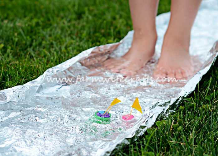 This tin foil river is an easy way to get kids outside this summer!