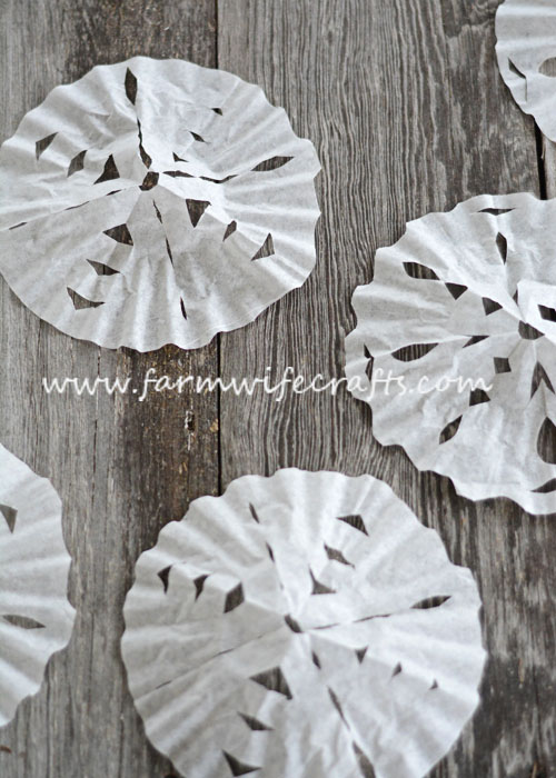 Looking for a quick, easy way to entertain the kids for a few minutes this winter? These Coffee Filter Snowflakes are the perfect cure for cabin fever!