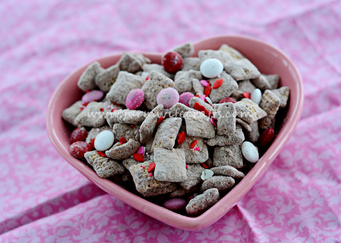 Are you looking for a Valentine's Day treat that your loved ones won't be able to resist? This Valentine's Puppy Chow is exactly what you need in your life. It's so easy to make and the perfect mixture of sweetness to make your mouth water?