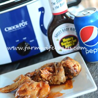 Looking for an easy slowcooker recipe for the big game? These Slowcooker Honey BBQ Wings are so easy to whip up and you can cook them in the crockpot while you get everything else ready or enjoy time with your guests!
