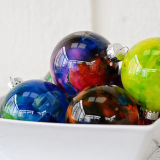 Do you have any holiday traditions?  We have a few and one of them is that the girls make a new ornament every year like these Melted Crayon Ornaments.