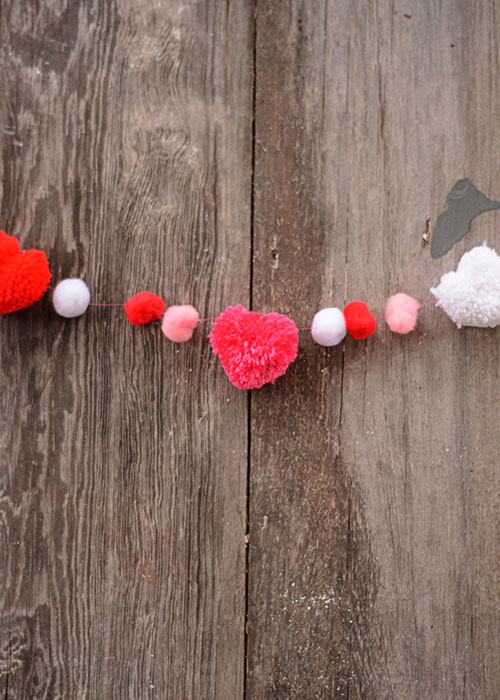Valentine's Day is right around the corner.  I love decorating for Valentine's Day.  I don't have a lot of decorations, but what I do have, are pretty simple and the pop of color definitely brightens up the drab winter days.  This DIY Valentine's Garland is a perfect addition to our decor!