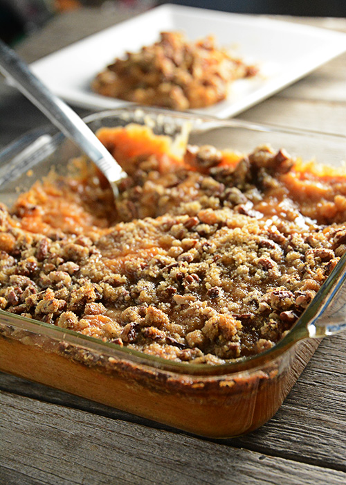 Trying to figure out what to take to that holiday pitch-in?  This Sweet Potato Casserole is a favorite at our holiday get-togethers