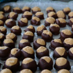 Buckeyes. They're a Christmas favorite and one of the most popular holiday foods to make and share with friends and family. They are so easy to make and so yummy. You will have a hard time giving them away because they are so good!