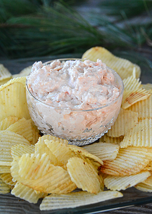 Are you looking for a decadent appetizer to serve at your holiday gathering?  Look no further than this recipe for Shrimp Dip!
