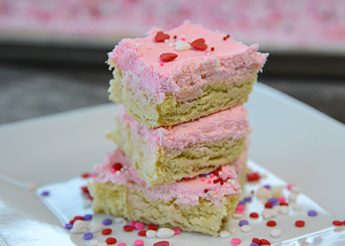 Do you love iced sugar cookies?  Then you need to try these Fluffy Sugar Cookie Bars.  Easy to whip up and with just the right amount of almond flavor they are delicious!