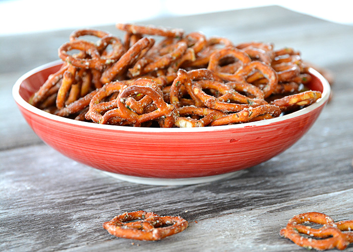 Are you looking to spice up those boring pretzels to serve at your next get-together?  These Seasoned Pretzels are easy to whip up with only a few ingredients and are a definite crowd pleaser!